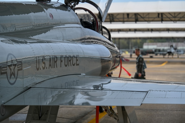 U.S. Air Force 1st Lt. Jared Rackers, 49th FTS Introduction to Fighter Fundamentals graduate, walks in front of a T-38 Talon Nov. 11, 2020, on Columbus Air Force Base, Miss. The T-38 is a two-seat trainer jet used by student pilots selected for the fighter track in pilot training. (U.S. Air Force photo by Airman 1st Class Davis Donaldson)