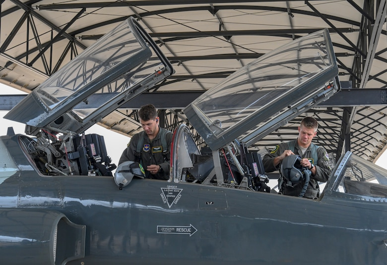 U.S. Air Force Capt. Cole Stegeman (left), 49th Fighter Training Squadron instructor pilot, and 1st Lt. Jared Rackers, 49th FTS Introduction to Fighter Fundamentals graduate, prepare for a flight in a T-38 Talon Nov. 11, 2020, on Columbus Air Force Base, Miss. Stegeman and Rackers both hail from a town called Jefferson City in Missouri and graduated from the same high school. (U.S. Air Force photo by Airman 1st Class Davis Donaldson)