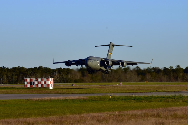 A C-17 Globemaster III assigned to Joint Base Charleston prepares to land at McEntire Joint National Guard Base, S.C., Nov. 16, 2020. Palmetto Challenge is a global mobilization exercise held at McEntire Joint National Guard Base, S.C. The exercise is held in order to develop readiness and awareness in a simulated deployed environment for over 100 Airmen from Joint Base Charleston.
