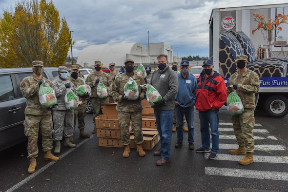 U.S. Air Force Airmen from the 4th, 7th and 8th Airlift Squadrons help distribute turkeys during Operation Turkey Drop at Joint Base Lewis-McChord, Wash., Nov. 17, 2020. The Air Force Association McChord Field Chapter and the Pierce Military and Business Alliance organized the drop of more than 400 turkeys to Airmen at Joint Base Lewis-McChord for the Thanksgiving holiday. (U.S. Air Force photo by Airman 1st Class Callie Norton)
