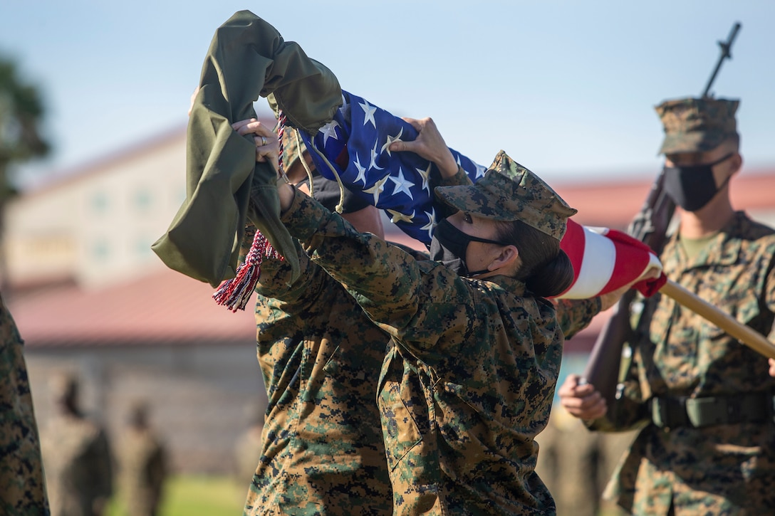 A U.S. Marine uncases the American flag during a ceremony on Marine Corps Base Camp Pendleton, Calif., Nov. 20.