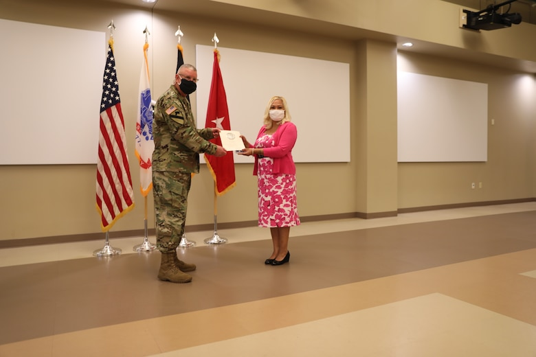 U.S. Army Civil Affairs and Psychological Operations Command (Airborne) Commanding General, Brig. Gen. Jeffrey C. Coggin, presents the Federal Length of Service Award to Ivy J. Mata for 25 years of federal service during the Soldier and Department of the Army Civilian recognition award ceremony at USACAPOC(A) Headquarters, Fort Bragg, N.C., Nov. 17, 2020. The recognition award ceremony was held to recognize 12 USACAPOC(A) Soldiers and DA civilians for Federal Length of Service Awards, Honorary Awards, Retirement recognition, and military awards.