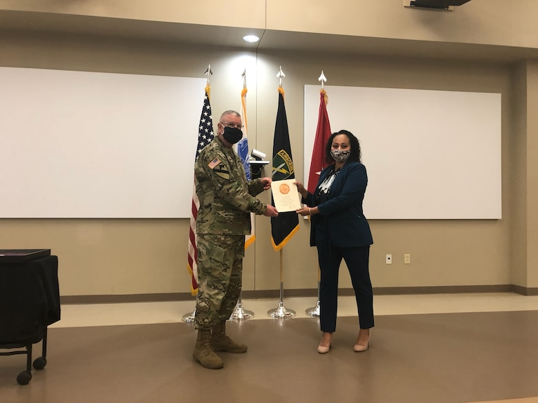 U.S. Army Civil Affairs and Psychological Operations Command (Airborne) Commanding General, Brig. Gen. Jeffrey C. Coggin, presents the Federal Length of Service Award to Kasandra Herbert for 5 years of federal service during the Soldier and Department of the Army Civilian recognition award ceremony at USACAPOC(A) Headquarters, Fort Bragg, N.C., Nov. 17, 2020. The recognition award ceremony was held to recognize 12 USACAPOC(A) Soldiers and DA civilians for Federal Length of Service Awards, Honorary Awards, Retirement recognition, and military awards.