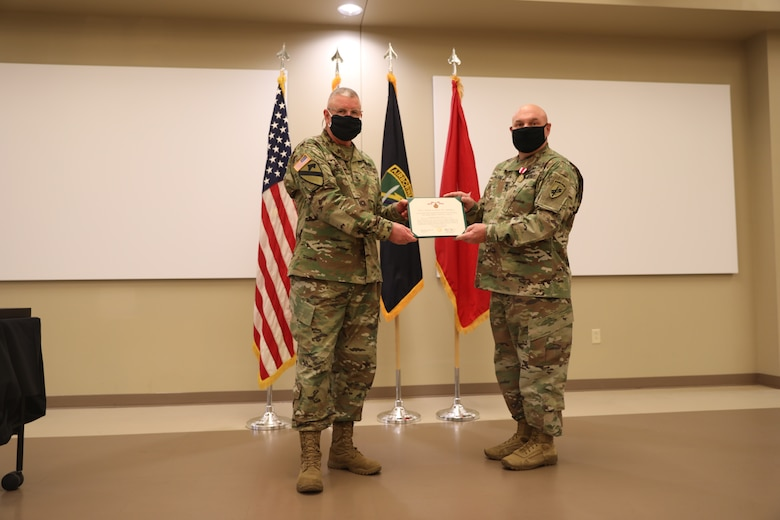 U.S. Army Civil Affairs and Psychological Operations Command (Airborne) Commanding General, Brig. Gen. Jeffrey C. Coggin, presents the Meritorious Service Medal to Master Sgt. Mark D. Garland during the Soldier and Department of the Army Civilian recognition award ceremony at USACAPOC(A) Headquarters, Fort Bragg, N.C., Nov. 17, 2020 for service as the HHC USACAPOC(A) First Sergeant. The recognition award ceremony was held to recognize 12 USACAPOC(A) Soldiers and DA civilians for Federal Length of Service Awards, Honorary Awards, Retirement recognition, and military awards.