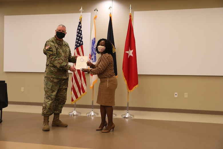 U.S. Army Civil Affairs and Psychological Operations Command (Airborne) Commanding General, Brig. Gen. Jeffrey C. Coggin, presents the Federal Length of Service Award to Shirleen E. Gandy for 25 years of federal service during the Soldier and Department of the Army Civilian recognition award ceremony at USACAPOC(A) Headquarters, Fort Bragg, N.C., Nov. 17, 2020. The recognition award ceremony was held to recognize 12 USACAPOC(A) Soldiers and DA civilians for Federal Length of Service Awards, Honorary Awards, Retirement recognition, and military awards.