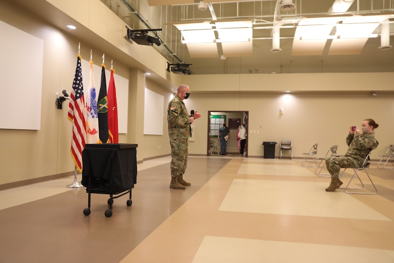 U.S. Army Civil Affairs and Psychological Operations Command (Airborne) Commanding General, Brig. Gen. Jeffrey C. Coggin speaks during the Soldier and Department of the Army Civilian recognition award ceremony at USACAPOC(A) Headquarters on Fort Bragg, N.C., Nov. 17, 2020. The recognition award ceremony was held to recognize 12 USACAPOC(A) Soldiers and DA civilians for Federal Length of Service Awards, Honorary Awards, Retirement recognition, and military awards.