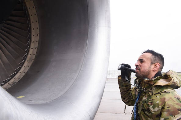 U.S. Air Force Tech. Sgt. Elliot Rivera, 100th Aircraft Maintenance Squadron propulsion craftsman, inspects the inner engine of a KC-135 Stratotanker aircraft at Royal Air Force Mildenhall, England, Oct. 29, 2020. The 100th Maintenance Group ensures the Bloody Hundredth's KC-135 Stratotanker aircraft are able to provide rapid global mobility and aerial refueling capability to the U.S. Air Force and NATO partners and allies, 24 hours a day, 365 days a year. (U.S. Air Force photo by Airman 1st Class David Busby)