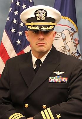 201124-N-N0443-8000 PENSACOLA, Fla. (Nov. 24, 2020) Official photo of Cmdr. Michael E. Lofgren. (U.S. Navy photo)