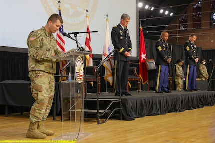 Maj. David Evan, chaplain, District of Columbia National Guard, delivers an invocation prior to the DCNG Land Component Command change of responsibility ceremony