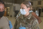 U.S. Army Cpl. Lauren Mangee, a combat medic assigned to the Macon-based Charlie Company, 148th Brigade Support Battalion, 48th Infantry Brigade Combat Team, Georgia Army National Guard, prepares a Soldier for a flu vaccine during drill weekend, Nov. 14, 2020, at the unit's armory in Macon, Georgia. Preventative medical care not only ensures unit readiness, but also promotes the health and welfare of Soldiers. (U.S. Army National Guard photo by Capt. Bryant Wine)