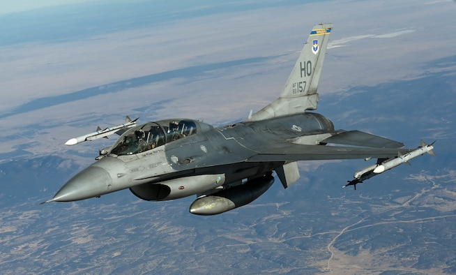 An F-16 Fighting Falcon from the 311th Fighter Squadron, flies above New Mexico during an aerial refueling training mission Nov. 20, 2020. (U.S. Air Force photo by Senior Airman Mary Begy)