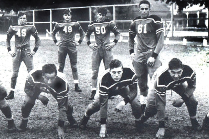 A football team poses for a photo.
