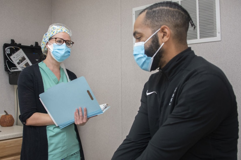 A nurse and patient interact.
