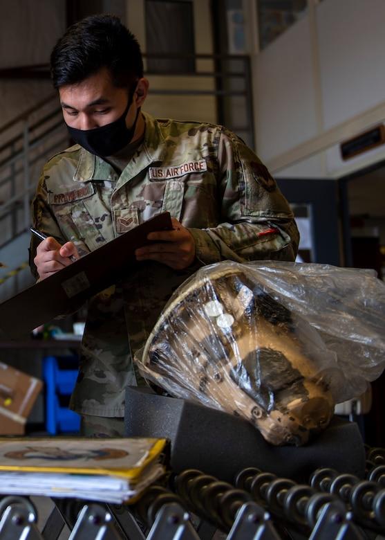 Senior Airman Rommel Francisco, 4th Logistics Readiness flight service center technicians, verify an F-15E Strike Eagle part at Seymour Johnson Air Force Base, North Carolina, Nov. 6, 2020.