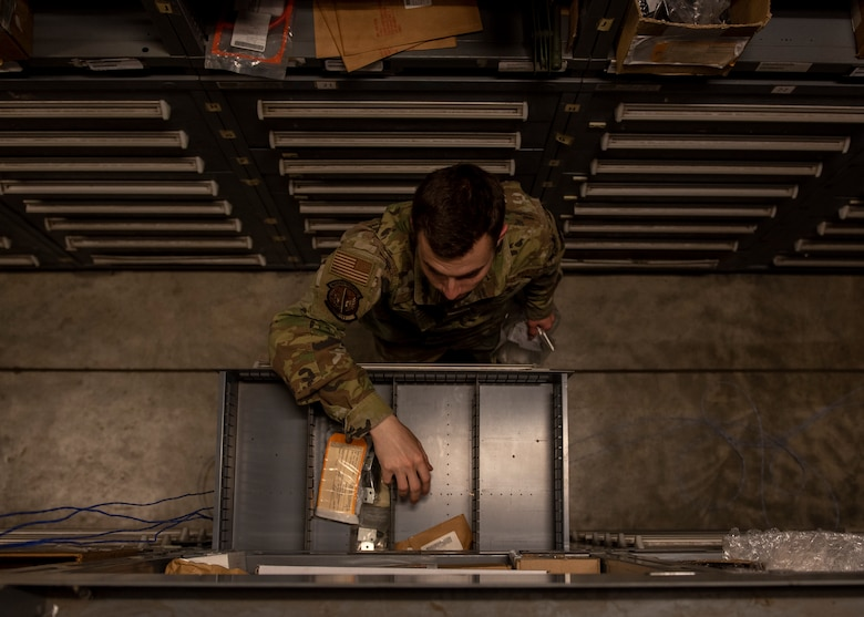 Airman 1st Class Ryan Kekic, 4th Logistics Readiness Squadron warehouse maintainer, grabs a part for an F-15E Strike Eagle engine at the aircraft parts store on Seymour Johnson Air Force Base, North Carolina, Nov. 6, 2020.