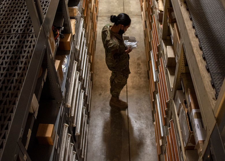 Airman 1st Class Roan Chong, 4th Logistics Readiness Squadron warehouse maintainer, grabs a part for an F-15E Strike Eagle engine at the aircraft parts store on Seymour Johnson Air Force Base, North Carolina, Nov. 6, 2020