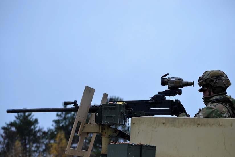 A 3-71 CAV, 10 MTN DIV Soldier takes aim with an M2 .50 caliber machine gun outfitted with the FWS-CS during testing at Fort Drum, NY