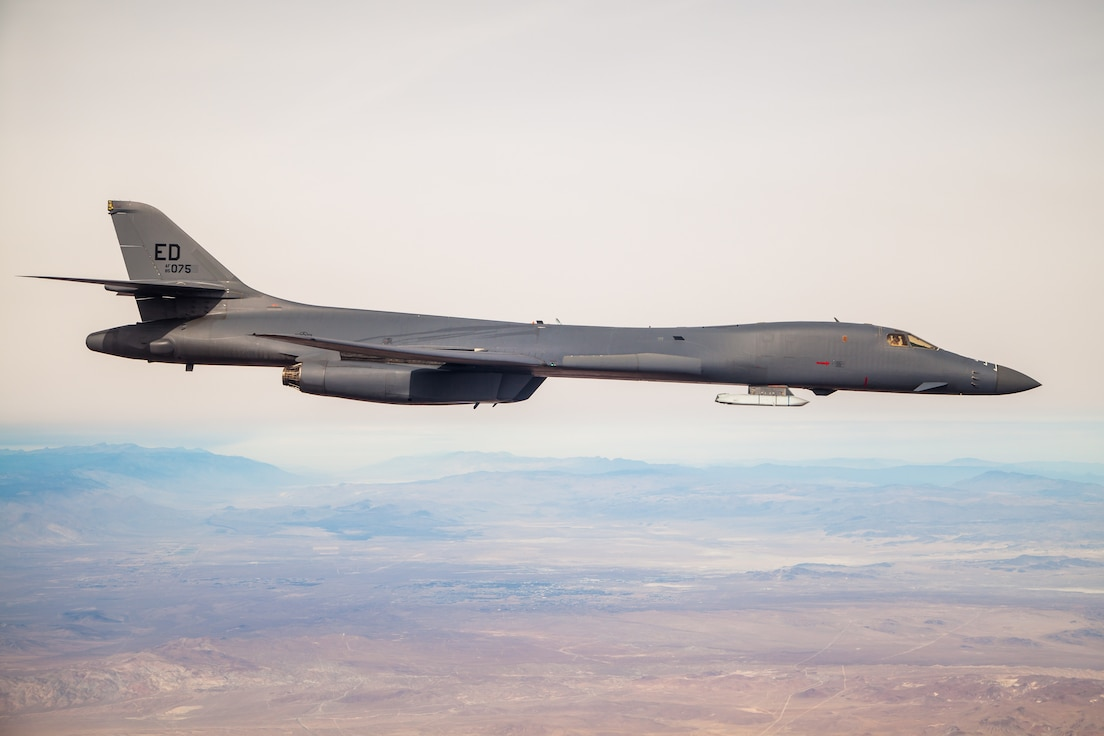 A B-1B Lancer with a Joint Air-to-Surface Standoff Missile (JASSM) flies in the skies above Edwards Air Force Base, California, Nov. 20. The flight was a demonstration of the B-1B's external weapons carriage capabilities. (Air Force photo by Ethan Wagner)