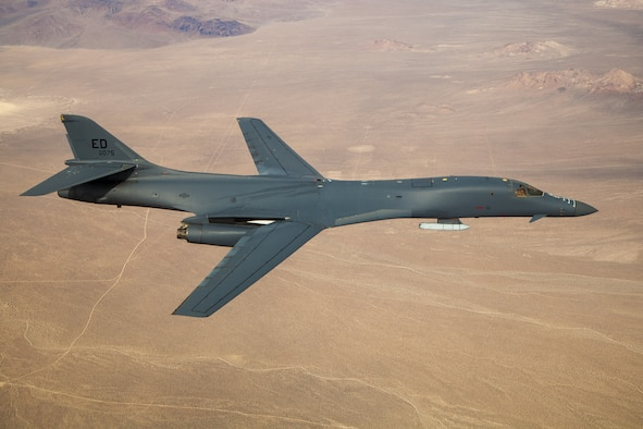 A B-1B Lancer prepares to conduct a captive carry flight to demonstrate its external weapons carriage capabilities at Edwards Air Force Base, California, Nov. 20. (Air Force photo by 2nd Lt. Christine Saunders)