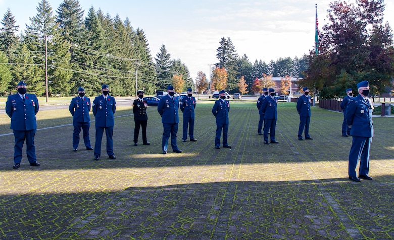 Canadian Detachment members stand at parade rest