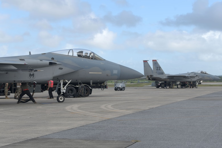"""The 18th Logistics Readiness Squadron refuels two F-15C Eagles during a """"Super Surge,"""" Nov. 18, 2020, at Kadena Air Base, Japan. The LRS team bested their most gallons in a single day since 2016 with 420,000 by the second day of the surge. (U.S. Air Force photo by Airman 1st Class Rebeckah Medeiros)"""