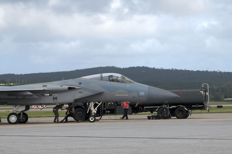 """Airmen from the 18th Logistics Readiness Squadron showcase a new hot pit refueling flow during a """"Super Surge,"""" Nov. 18, 2020, at Kadena Air Base, Japan. The LRS team pumped 1,389,391 gallons of fuel; 650,417 gallons were for the F-15C Eagles alone. (U.S. Air Force photo by Airman 1st Class Rebeckah Medeiros)"""