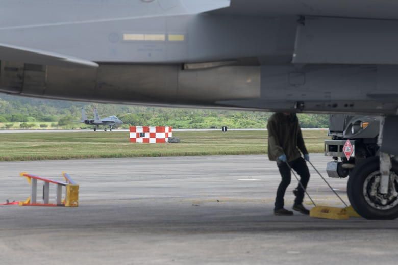 """An F-15C Eagle taxis down the flight line of Kadena Air Base, Japan, during a """"Super Surge,"""" Nov. 18, 2020. The 44th and 67th Fighter Squadrons set a new record for the most F-15C Eagles flown in a week at 437 sorties; the previous record was 245 sorties. (U.S. Air Force photo by Airman 1st Class Rebeckah Medeiros)"""