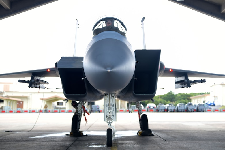 """An F-15C Eagle sits on the flight line for maintenance during a """"Super Surge,"""" Nov. 18, 2020, at Kadena Air Base, Japan. The 44th and 67th Fighter Squadrons set a new record for the most F-15C Eagles flown in a week at 437 sorties; the previous record was 245 sorties. (U.S. Air Force photo by Airman 1st Class Rebeckah Medeiros)"""