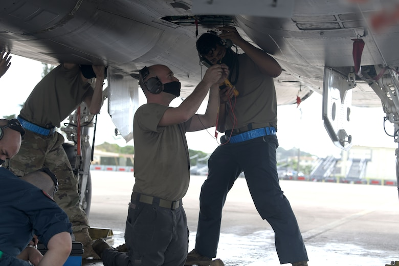 """Airmen from the 44th Aircraft Maintenance Unit perform tests on the F-15C Eagle components for any malfunctions during a """"Super Surge,"""" at Kadena Air Base, Japan, Nov. 18, 2020. The 44th and 67th AMUs and Fighter Squadrons flew 437 sorties during the surge. (U.S. Air Force photo by Airman 1st Class Rebeckah Medeiros)"""