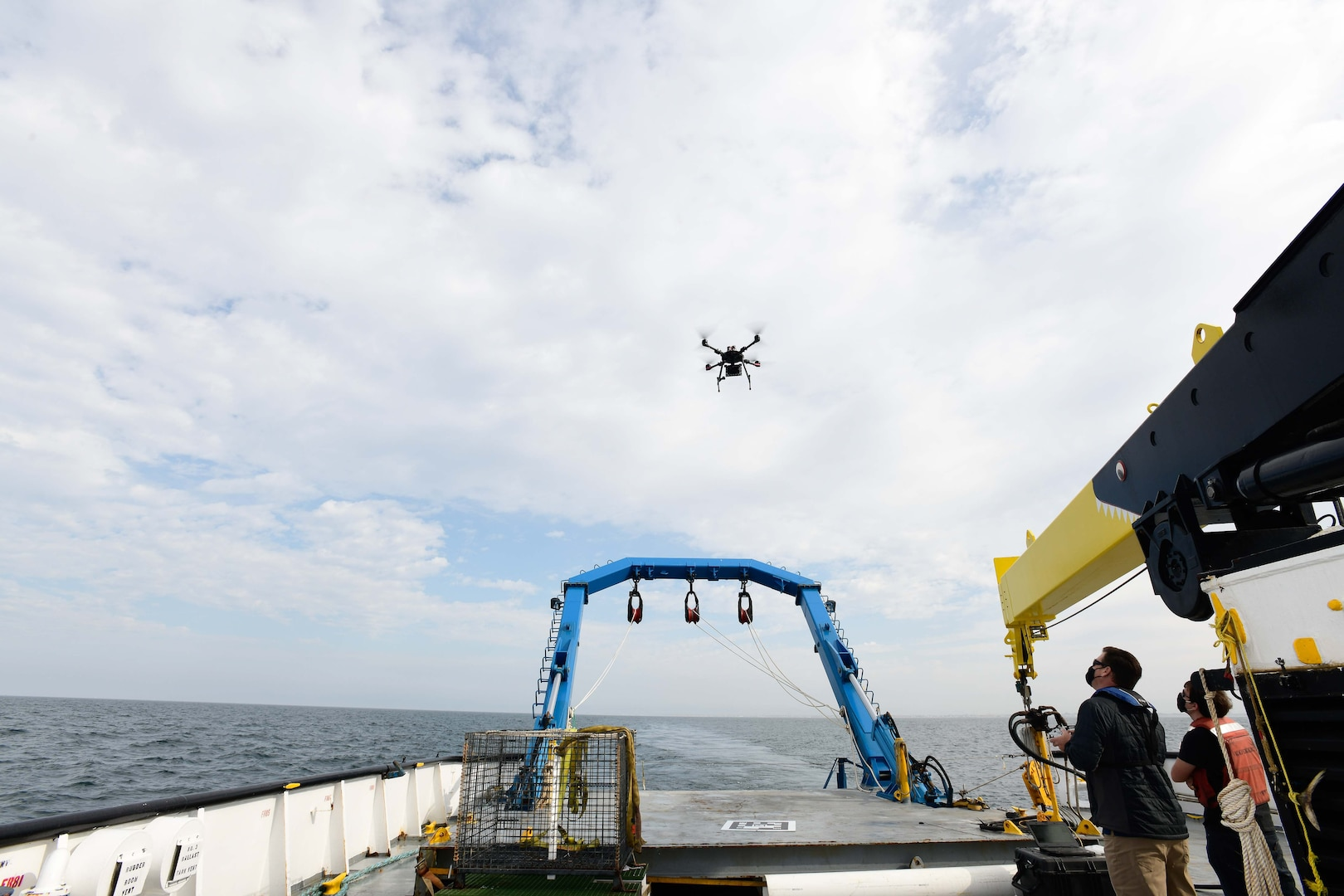 Alan Jaeger, Naval Surface Warfare Center, Port Hueneme Division's Office Of Technology (00T) research and technology manager, and Ian Wilson, 00T's cybersecurity researcher, test out the capabilities of a quadcopter drone at the stern of a ship on Friday, Sept. 18.
