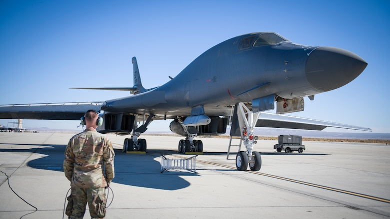 A B-1B Lancer with a Joint Air-to-Surface Standoff Missile (JASSM) undergoes pre-flight procedures prior to a captive carry external weapons demonstration flight at Edwards Air Force Base, California, Nov. 17. (Air Force photo by Giancarlo Casem)