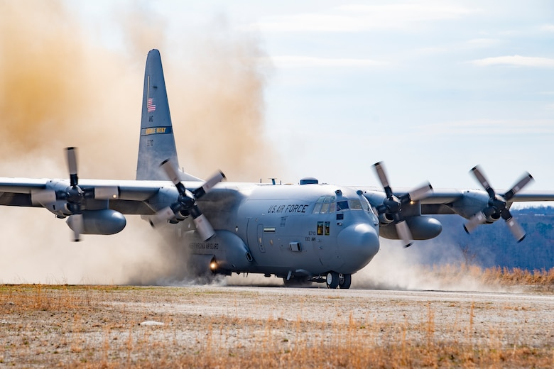 A 130th Airlift Wing C-130H lands during training Mar. 28, 2019 at Camp Branch, W.Va. Camp Branch is a dirt-strip landing and drop zone in Southern West Virginia, capable of hosting joint training for many different types of aircraft and personnel. (U.S. Air National Guard Photo by Senior Airman Caleb Vance)
