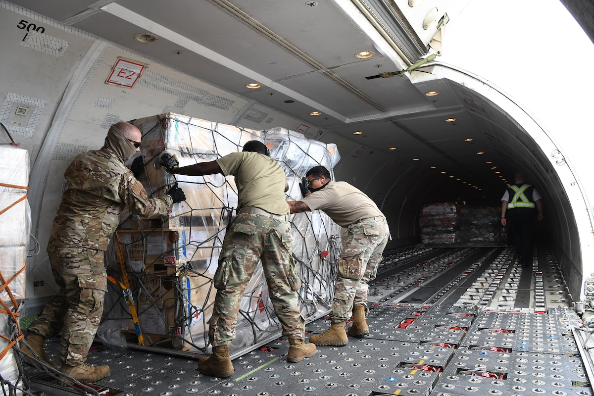 U.S. Air Force Airmen unload pallets of humanitarian assistance sent by the Canadian Red Cross to Honduras in response to hurricane Iota at Soto Cano Air Base in Honduras, Nov. 22, 2020.