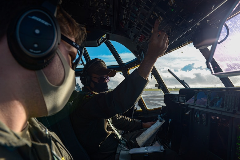 U.S. Air Force Capt. Andrew Zaldiver(left), and USAF Capt. Emery Gumapas, both C-130J Hercules pilots assigned to the 36th Airlift Squadron, Yokota Air Base, Japan, perform pre-inspections on a C-130J before takeoff during a Dynamic Force Employment at Andersen Air Force Base, Guam, Nov. 23,2020. DFE is an operational platform that allows our forces to be strategically predictable and operationally unpredictable. (U.S. Air Force photo by Senior Airman Michael S. Murphy)
