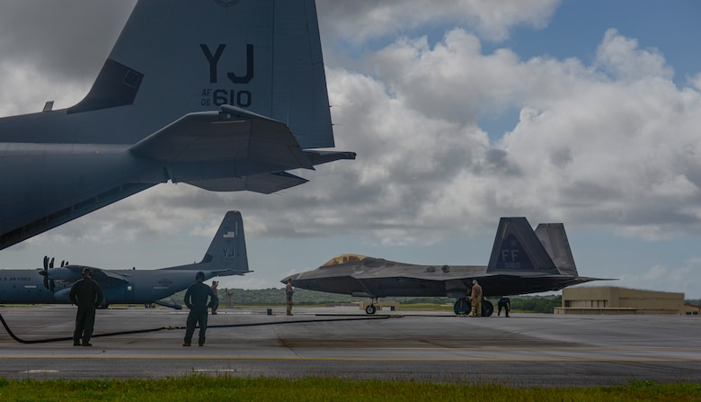 An F-22 Raptor assigned to the 94th Expeditionary Fighter Squadron completes a hot refuel from a fuel bladder carried by a C-130J Hercules assigned to the 36th Airlift Squadron, Yokota Air Base, Japan, during a Dynamic Force Employment at Andersen Air Force Base, Guam, Nov. 22, 2020. DFE is an operational platform that allows our forces to be strategically predictable and operationally unpredictable. The U.S. Air Force is postured and ready to respond to crises and contingencies throughout the U.S. Indo-Pacific Command, contributing to regional stability and a free and open Indo-Pacific. (U.S. Air Force photo by Senior Airman Michael S. Murphy)