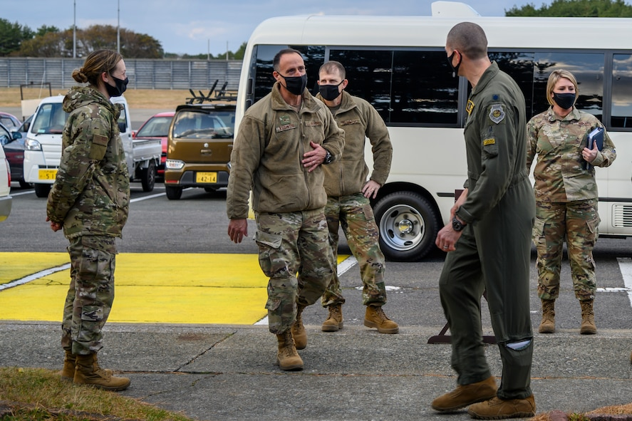 U.S. Air Force Brig. Gen. Leonard J. Kosinski, the 5th Air Force vice commander, and Chief Master Sgt. Kathleen McCool, 5th AF command chief, prepare to walk into the 14th Fighter Squadron at Misawa Air Base, Japan, Nov. 23, 2020. During their two-day visit, Kosinski and McCool received mission briefs from various 35th Fighter Wing units and agencies, had the opportunity to meet and interact with Airmen, and learn about the various roles Team Misawa members play to keep their community safe. (U.S. Air Force photo by Airman 1st Class China M. Shock)