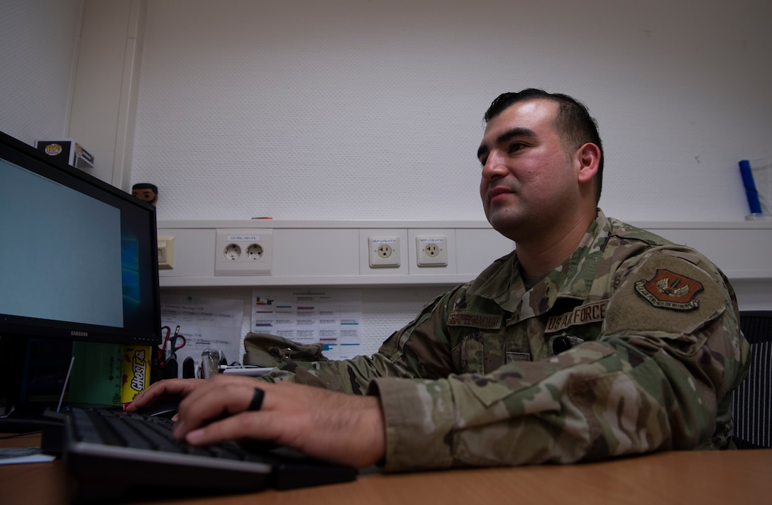 U.S. Air Force Tech. Sgt. Cesar Soto-Betancourt, 86th Dental Squadron general dentistry noncommissioned officer in charge, types an enlisted performance report at Ramstein Air Base, Germany, Nov. 23, 2020.