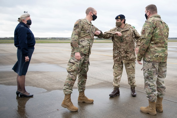 U.S. Air Force Lt. Col. Joseph Knothe, center left, 420th Air Base Squadron commander, welcomes British Army Lt. Gen. Ivan B. L. Jones CB, Commander Field Army, center right, at RAF Fairford, England, Nov. 17, 2020, during NATO Exercise Loyal Leda 2020 (LOLE20). Allied Land Command (LANDCOM) conducted a combat readiness evaluation on the NATO Headquarters Allied Rapid Reaction Corp (ARRC) during LOLE20, which took place at RAF Fairford and South Cerney, England, Nov. 9-19, 2020. This was a complex multi-domain exercise designed to test the war-fighting capabilities of the ARRC in a COVID-19 environment including combat operations. LOLE20 was a key NATO exercise to validate and certify the Gloucester-based ARRC as a NATO war-fighting corps at full operational readiness, capable of commanding up to 120,000 multinational troops across a full spectrum of military operations. (U.S. Air Force photo by Senior Airman Jennifer Zima)