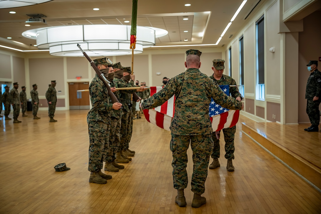 Col. Vincent Dawson, the commanding officer of Special Purpose Marine Air-Ground Task Force - Southern Command, and Sgt. Maj. Mark Murphy, the senior enlisted advisor of SPMAGTF-SC, case the unit colors during the SPMAGTF-SC closing ceremony in Camp Lejeune, North Carolina, Nov. 13, 2020. The ceremony marks the end of the sixth consecutive year the Marines and Sailors formed SPMAGTF-SC to serve as the crisis response force assigned to U.S. Southern Command. SPMAGTF-SC worked within the Latin American and Caribbean region conducting dynamic force employment training, enhancing combined crisis response and humanitarian aid efforts in the U.S. Southern Command area of responsibility. Dawson is a native of Portland, Oregon. Murphy is a native of Great Bend, Kansas. (U.S. Marine Corps photo by Sgt. Andy O. Martinez)