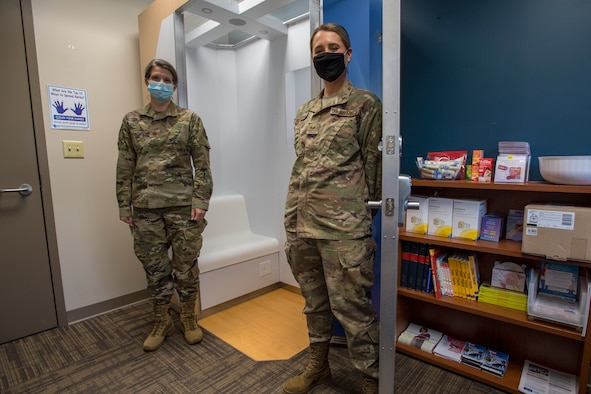 Maj. Brittany K. Hines, officer in charge fetal protection, and Staff Sgt. Caroline M. Schmauch, NCO in charge fetal protection with the 911th Aeromedical Staging Squadron pose in front of the unit's new lactation booth at Pittsburgh International Airport Air Reserve Station, Pennsylvania, October 4, 2020.