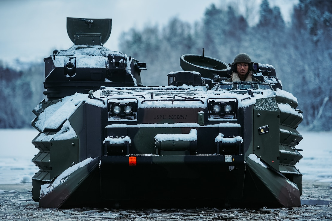 U.S. Marines conduct a safety of use memorandum on an assault amphibious vehicle in Setermoen, Norway, Nov. 19.