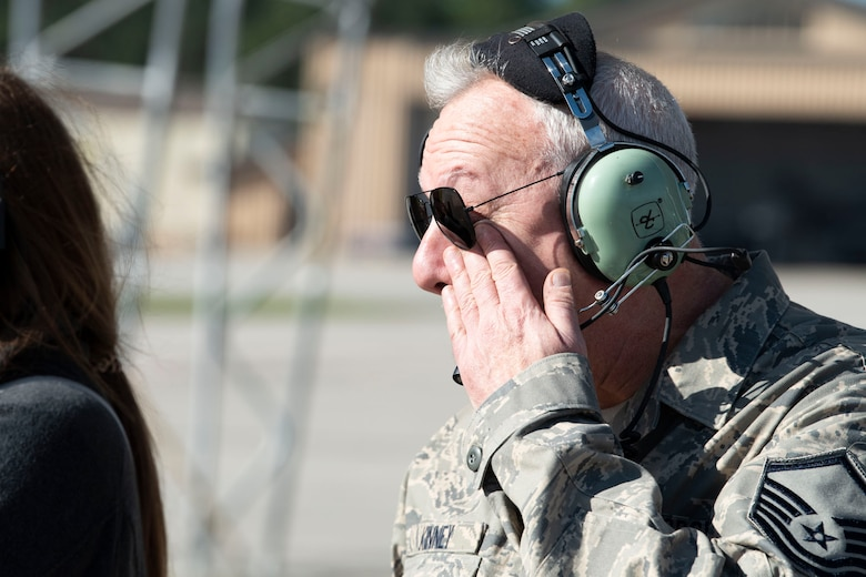 Retired crew chief wipes tear from his face.