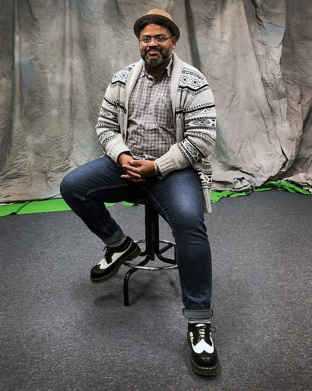 """Roderick """"Rick"""" Berry, 66th Air Base Group Public Affairs specialist, poses for a photo in the video production studio at Hanscom Air Force Base, Mass., earlier this month. Berry was recently named the Air Force Materiel Command outstanding civilian communicator, category one. (Courtesy Photo)"""