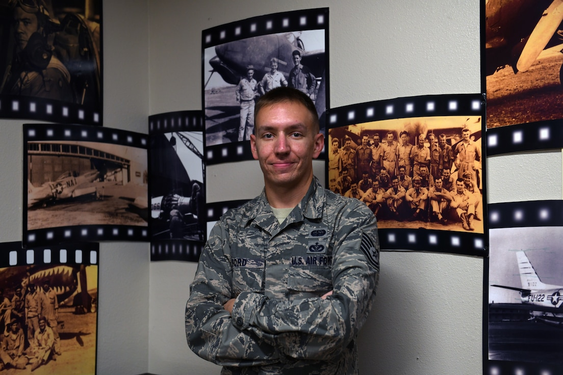 U.S. Air Force Tech. Sgt. Cameron Ford, 33rd Fighter Wing alternate communication security manager, poses for a photo in the 33rd FW heritage room Nov. 13, 2020, at Eglin Air Force Base, Florida. Ford was awarded the Air Force Information Dominance Award for Outstanding Cyber Operations Noncommissioned Officer and will represent the Air Force Education and Training Command against other major command winners across the Air Force. (U.S. Air Force photo by Senior Airman Amber Litteral)