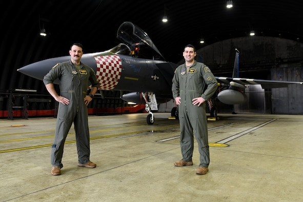 U.S. Air Force Capt. Gavin O'Boyle, 493rd Fighter Squadron chief of weapons, and U.S. Air Force Lt. Col. Mark Perry, 493rd FS director of operations, pose in front of the 48th Fighter Wing F-15C Eagle Heritage Jet, at Royal Air Force Lakenheath, England, Nov. 25, 2020. Perry, who was assigned as the pilot of the heritage jet back in 2009 as a young Lieutenant, is now designating O'Boyle as the new pilot of the aircraft. (U.S. Air Force photo by Senior Airman Christopher S. Sparks)