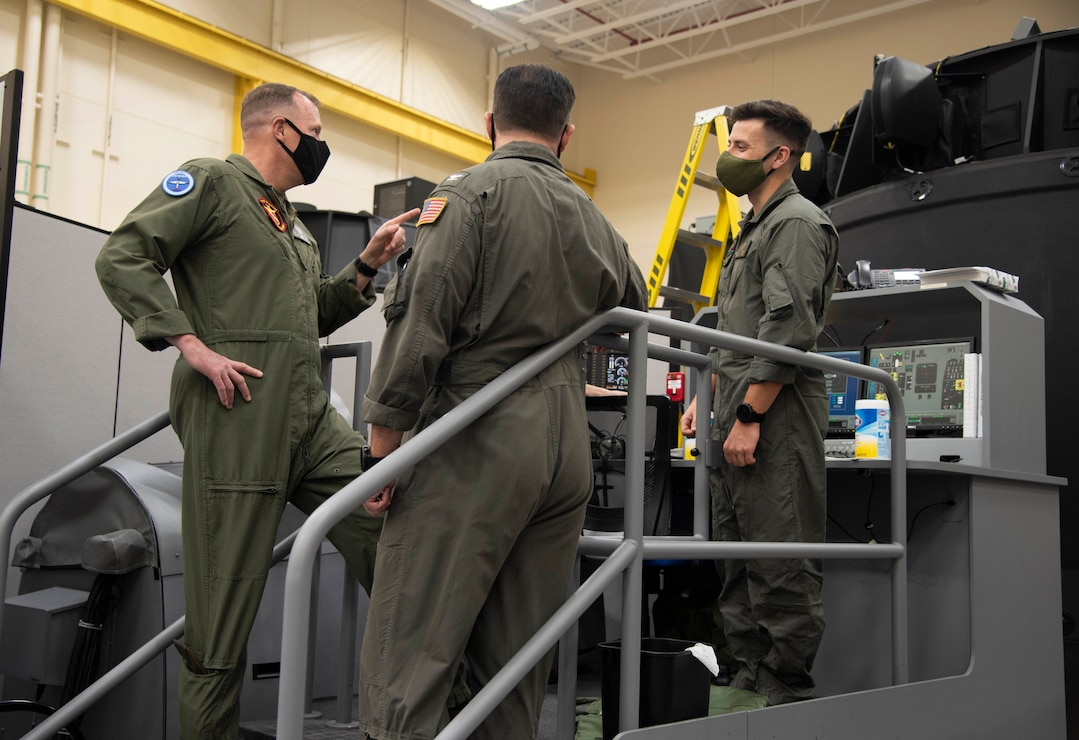 U.S. Marine Corps Deputy Commandant for Aviation Lt. Gen. Mark Wise speaks with a student naval aviator about a unit training device used for aircraft procedural training during a visit to Training Air Wing 4 at Naval Air Station Corpus Christi, Nov. 24, 2020.