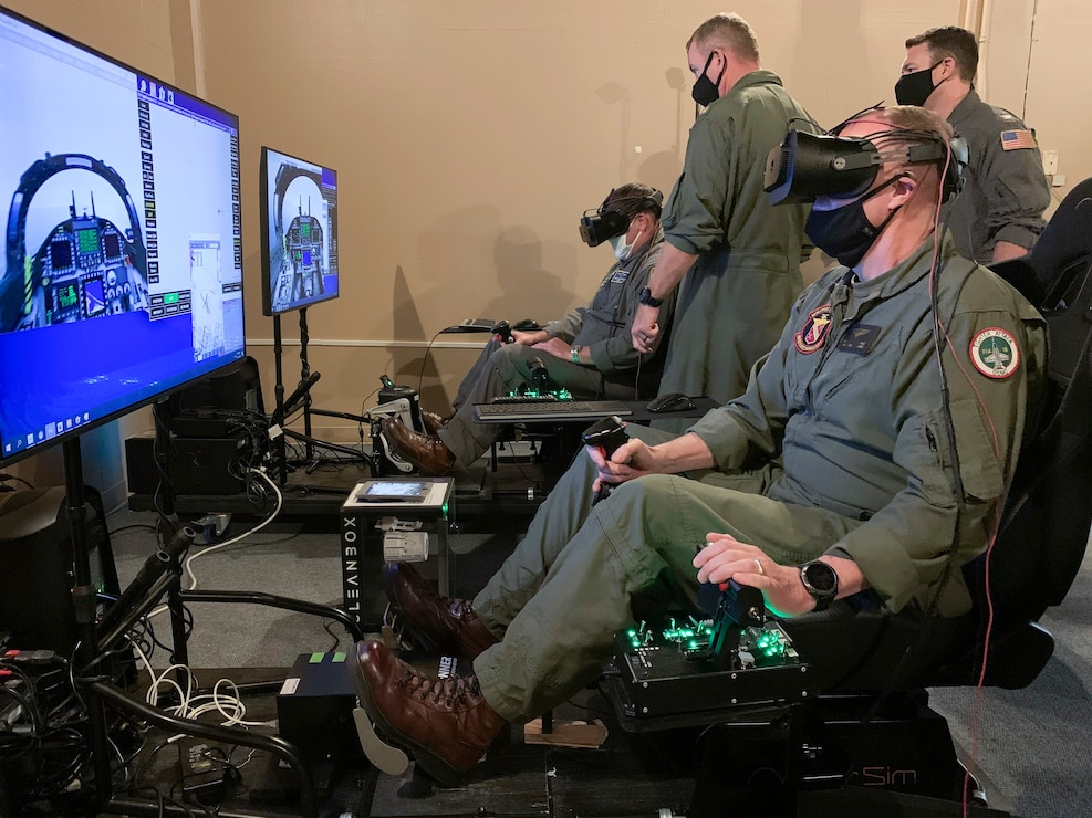 U.S. Marine Corps Deputy Commandant for Aviation Lt. Gen. Mark Wise, right, and Chief of Naval Air Training Rear Adm. Robert Westendorff, left, operate a virtual reality flight trainer, part of Naval Aviation Training Next - Project Avenger, during a visit to Training Air Wing 4 at Naval Air Station Corpus Christi, Nov. 24, 2020.