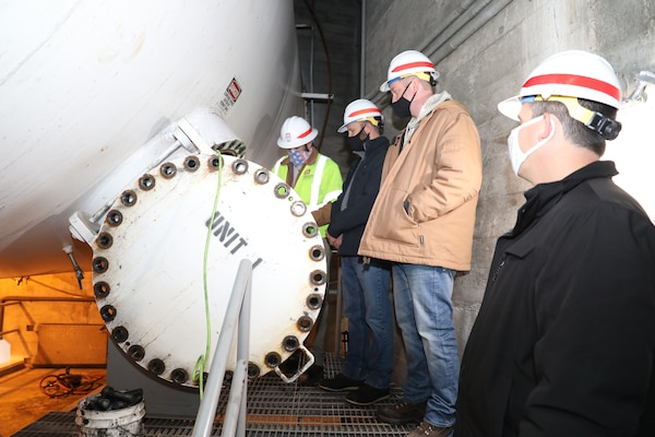 Members from the Omaha District's hydropower team prepare to enter a penstock to inspect a butterfly valve and turbine during a site visit to the Ft. Peck Dam in Montana, Oct. 29, 2020.
