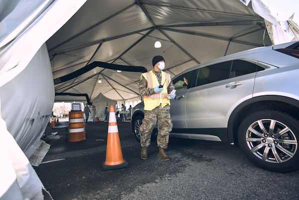 A New York Army National Guard Soldier guides a resident through a drive-through COVID-19 testing site in New Rochelle, N.Y., on Nov. 23, 2020. Across the state Guard Soldiers and Airmen have assisted in testing more than 832,000 people.
