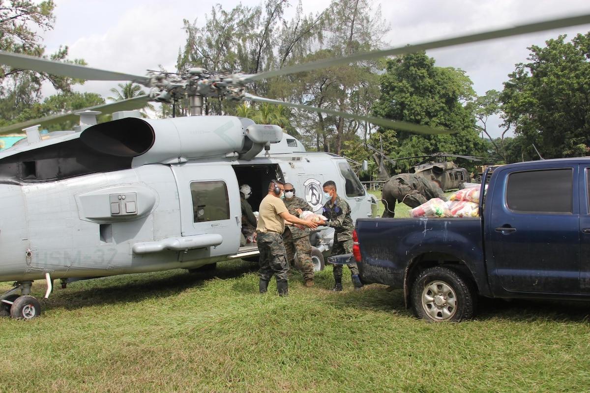 HSM-37 distribute relief supplies after Hurricane Iota in Honduras.